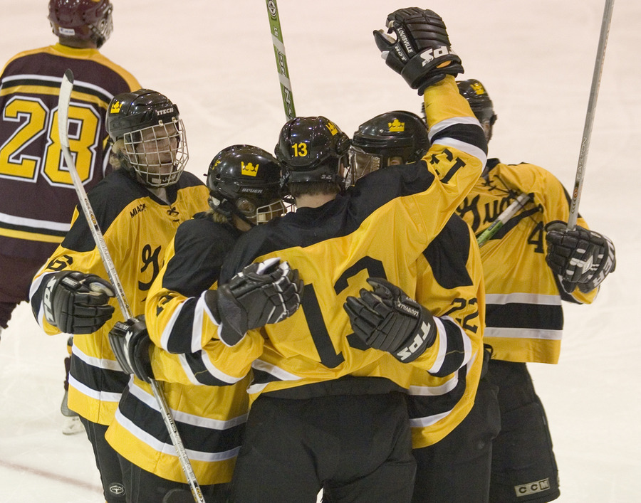 Keith Detlefsen and teammates celebrate his first period goal.