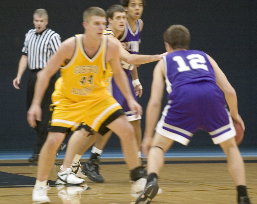 Gustavus' Phil Sowden defends Bryan Schnettler on the perimeter.