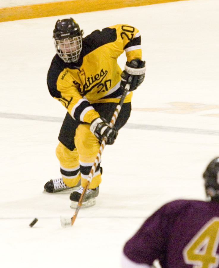 Junior Jon Keseley moves toward center ice with the puck.