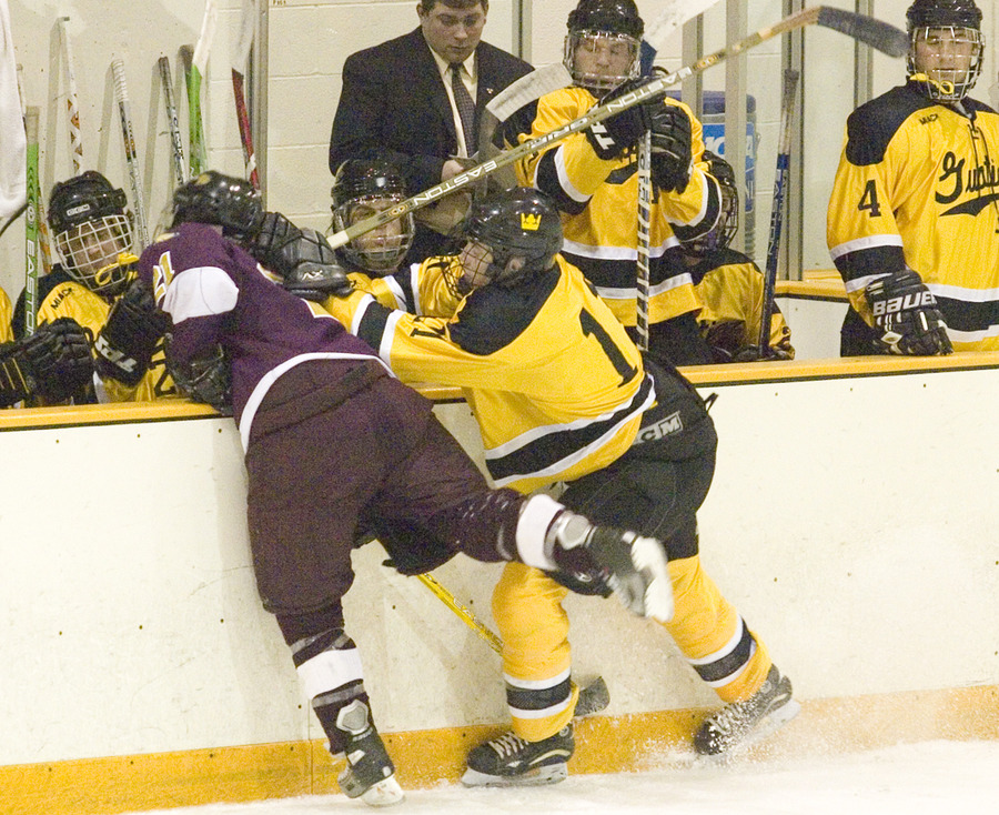 Eric Lindquist nearly sends a UM-Crookston player into the Gustavus bench.
