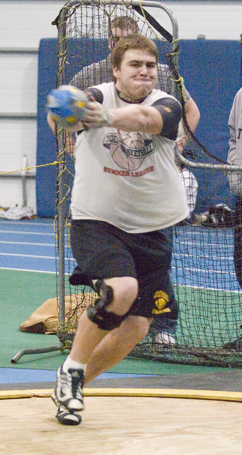 Junior Andy Klaers spins en route to a win in the weight throw.
