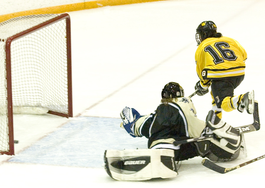 Ingrid Neve scores in the second period to give Gustavus a 9-1 lead.