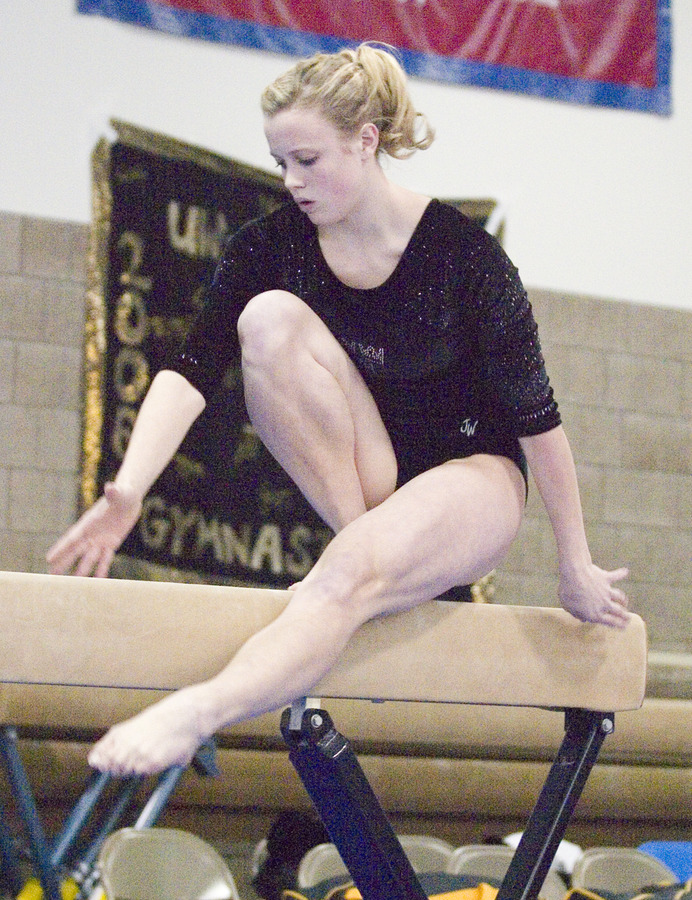 Nicole Gergen performs on the balance beam.