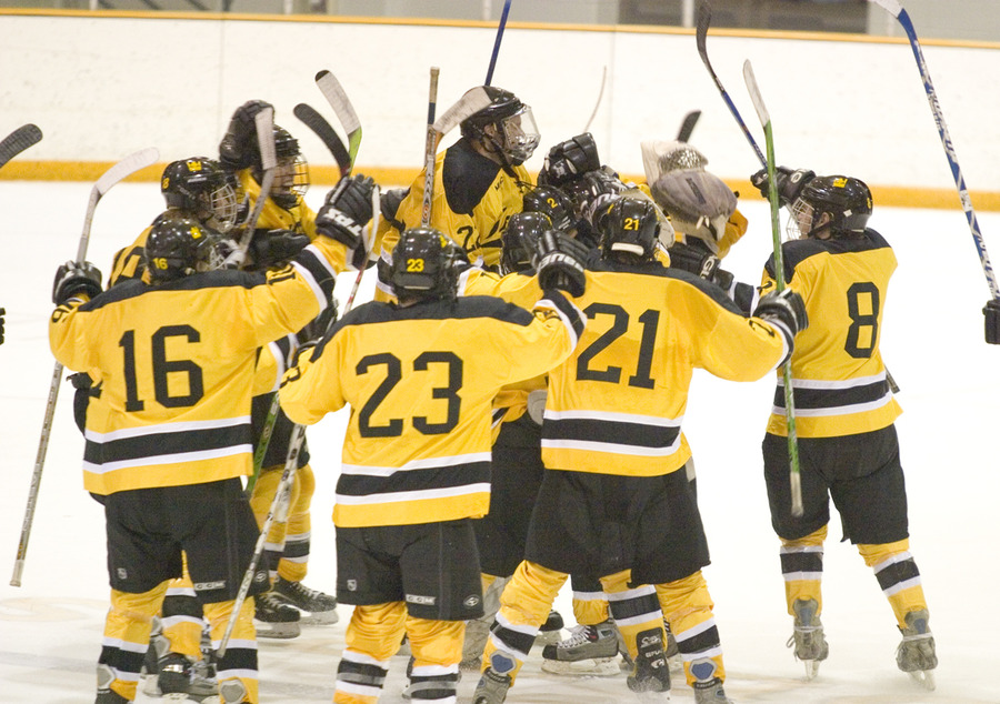 The Gusties celebrate their overtime victory against St. Olaf.