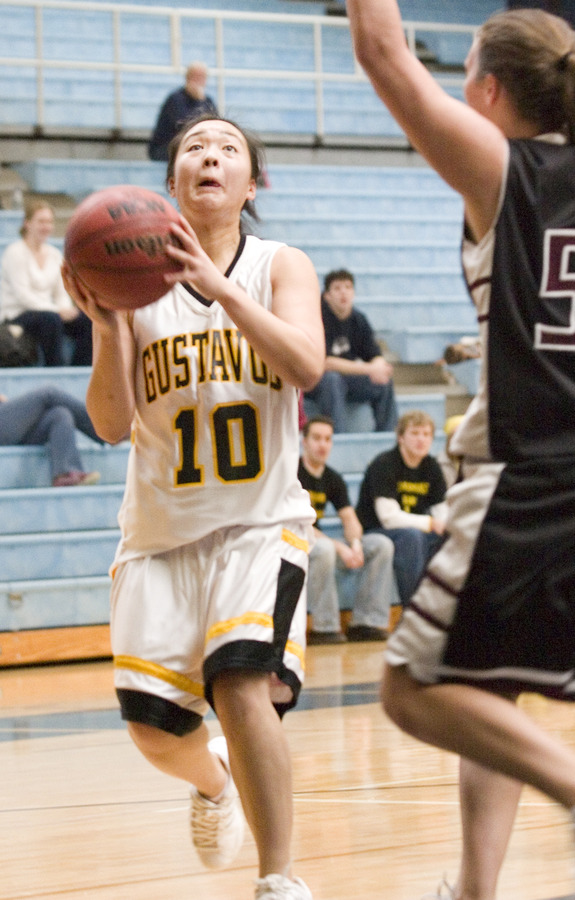 Senior Missy Mills drives through the lane for a lay-up.