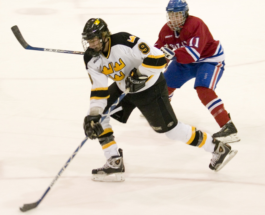 Cody Drysdale speeds past a Johnnie defender on a breakaway in the third period.