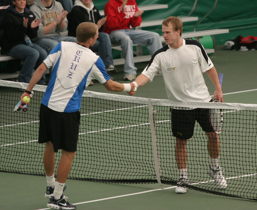 Loren Collins shakes hands with Matt Seeberger after winning at #1 singles.