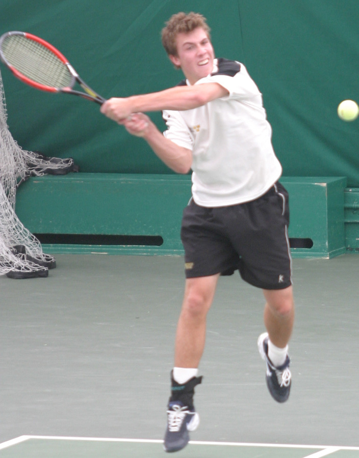 Andy Bryan rips a backhand return.