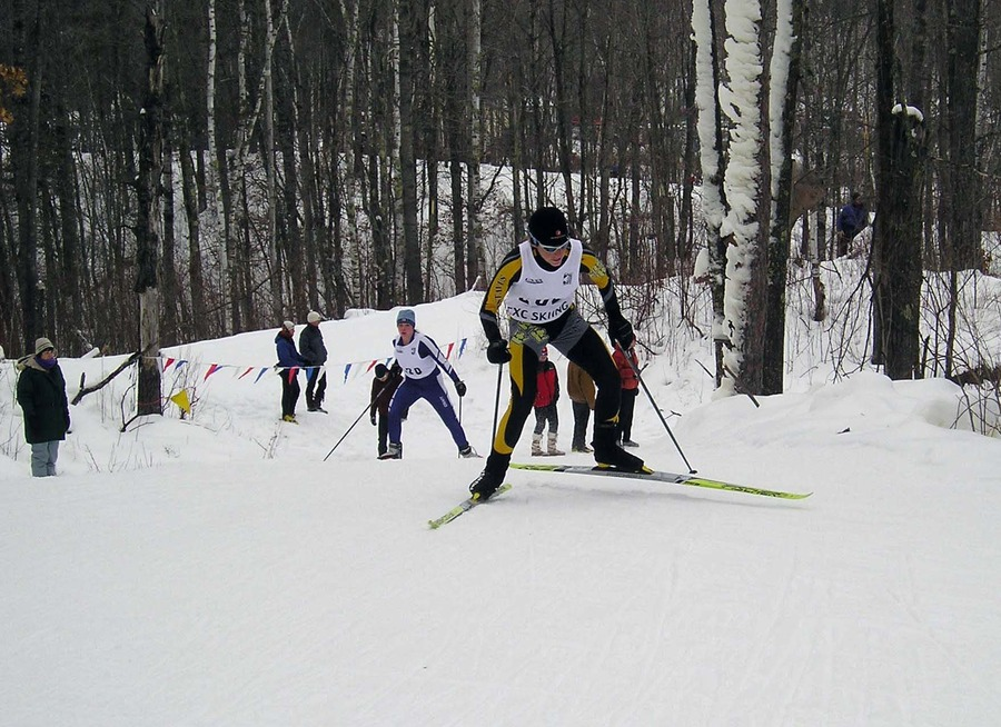 Daw uses the hills on the course at Mount Itasca to get an advantage on another skier.