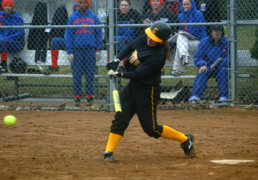 Audrey Lenoch drives a pitch up the middle.