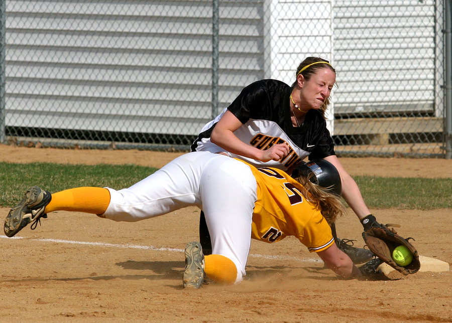 Julie Mahre attempts to tag out a Cobber runner.