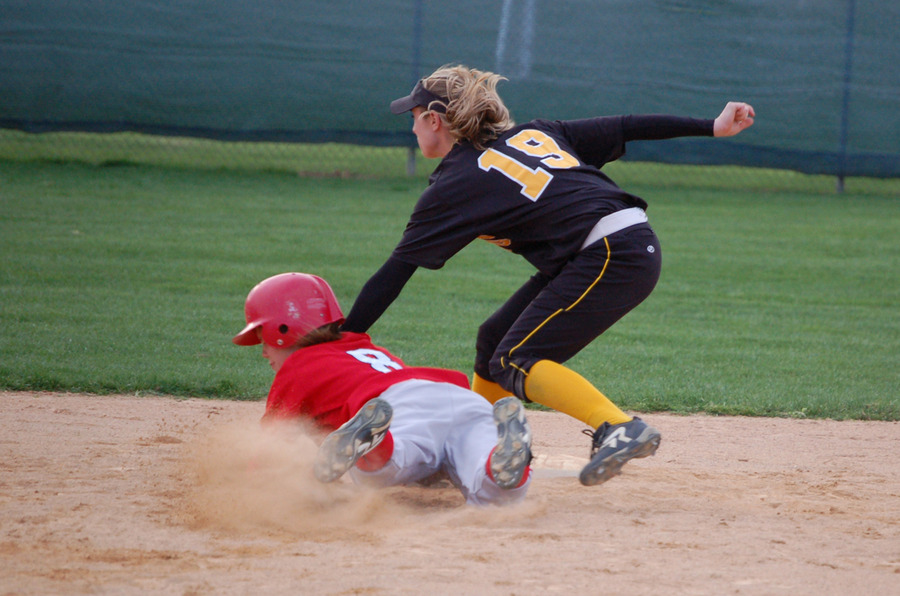 Julie Mahre tags a Cardinal runner out at second base.