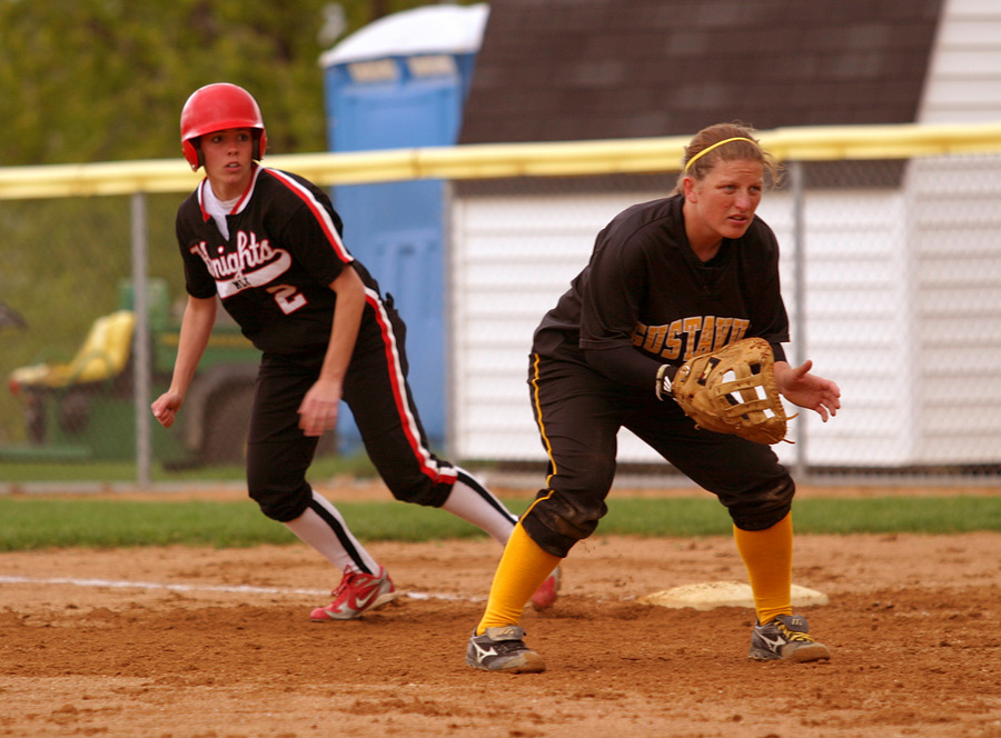 Senior Audrey Lenoch gets sets to field a bunt as a Martin Luther player leads off first base.