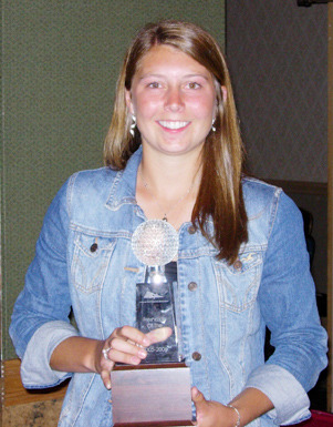 Kimbra Kosak displays her NGCA Division III Freshman of the Year Award