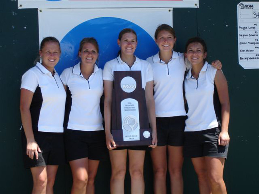 Women's golf team with second place NCAA trophy.