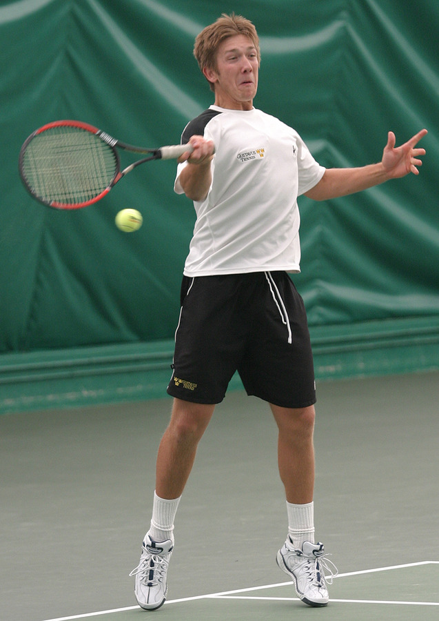 Bryan strokes a forehand.