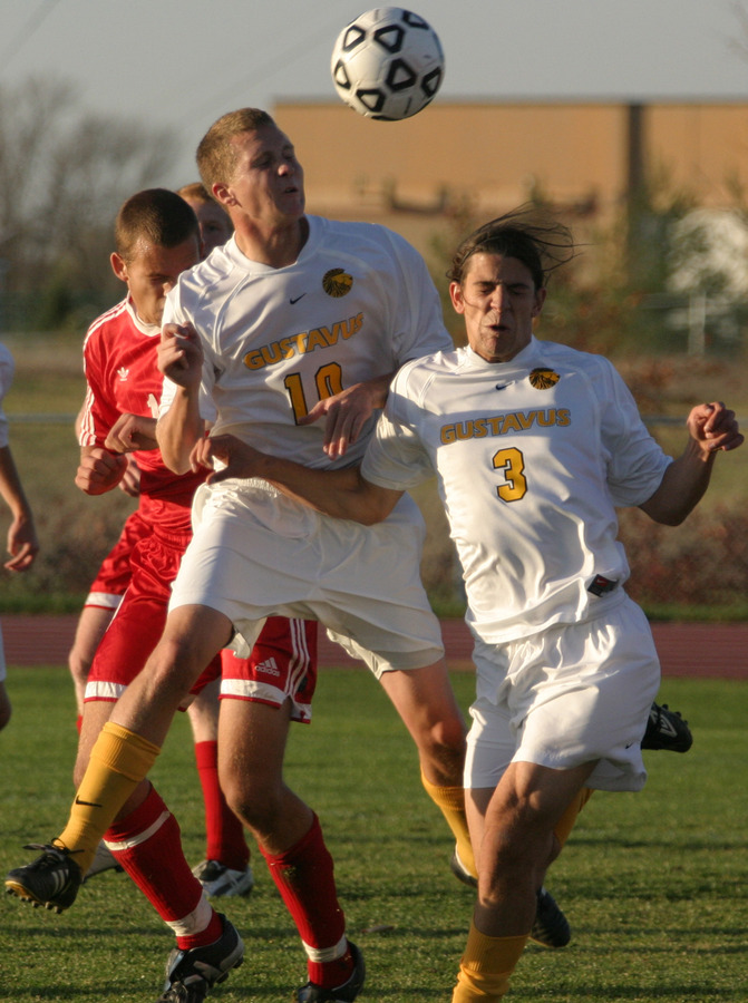Kroog heads the ball to a teammate against Saint John's