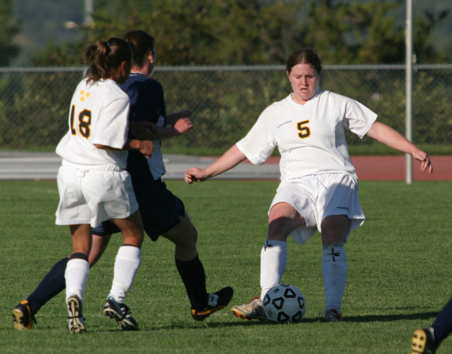 Senior Shannon Quealy (right) fights through a tackle.