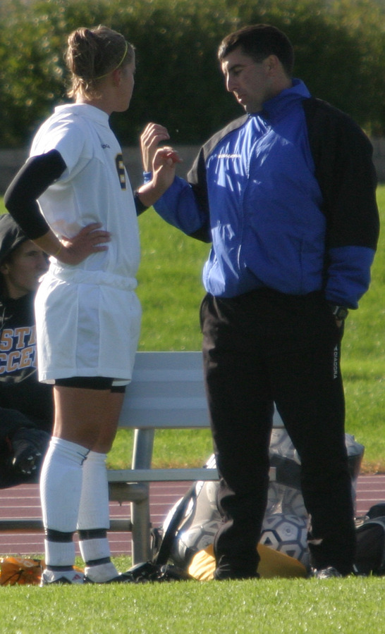 Coach Mike Stehlik instructs senior Amy Larson during a game last season.  Larson led the team with 11 points.
