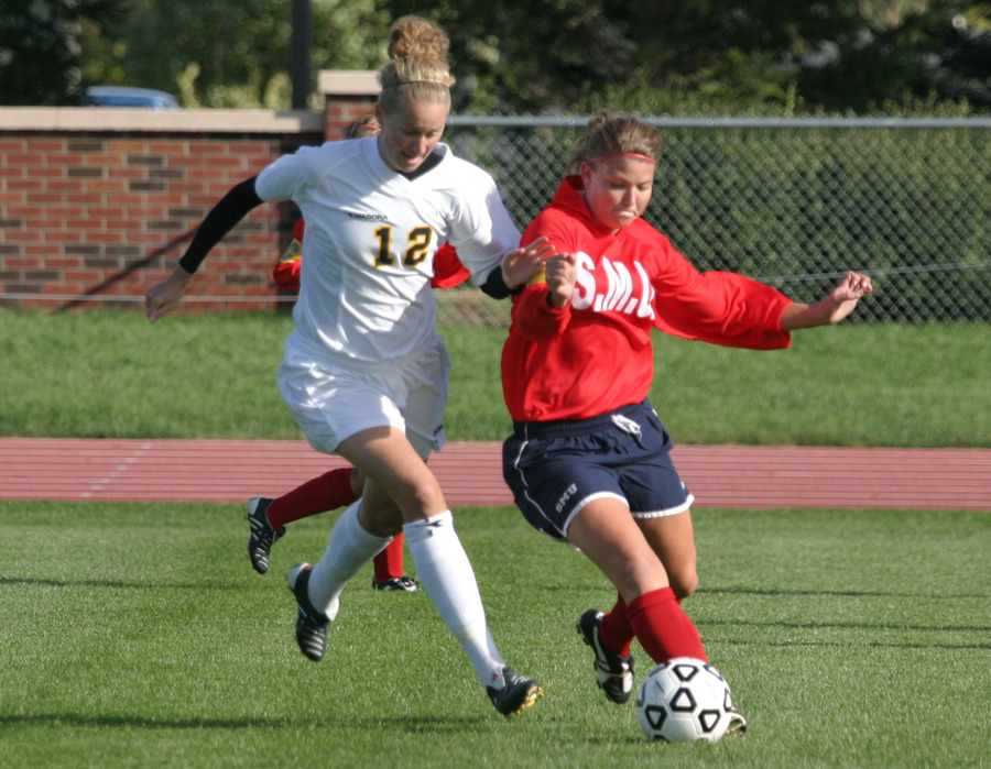 Senior Liz Peterson battles a Saint Mary's defender for the ball.