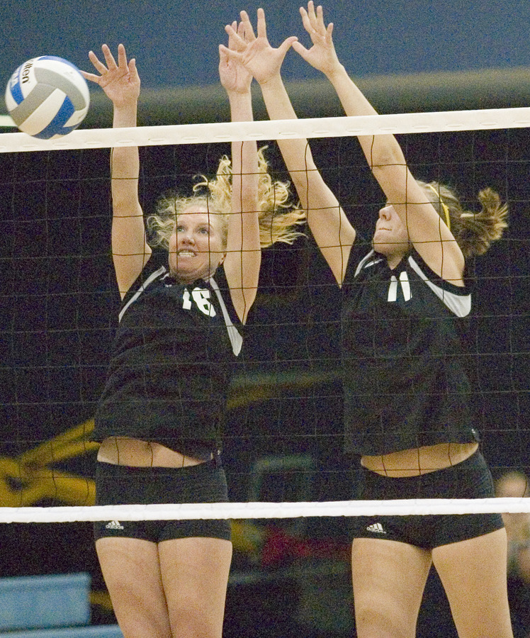 Jessica Plemel (left) and Danielle Gimmestad (right) try to block the ball.