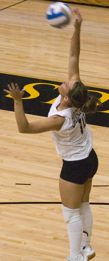 Emily Klein hits a serve for the Gusties.