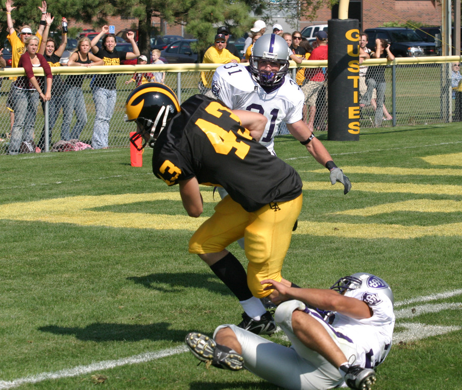 Sophomore wide receiver Chad Arlt breaks through a Tommy tackle to score the Gusties' lone touchdown.