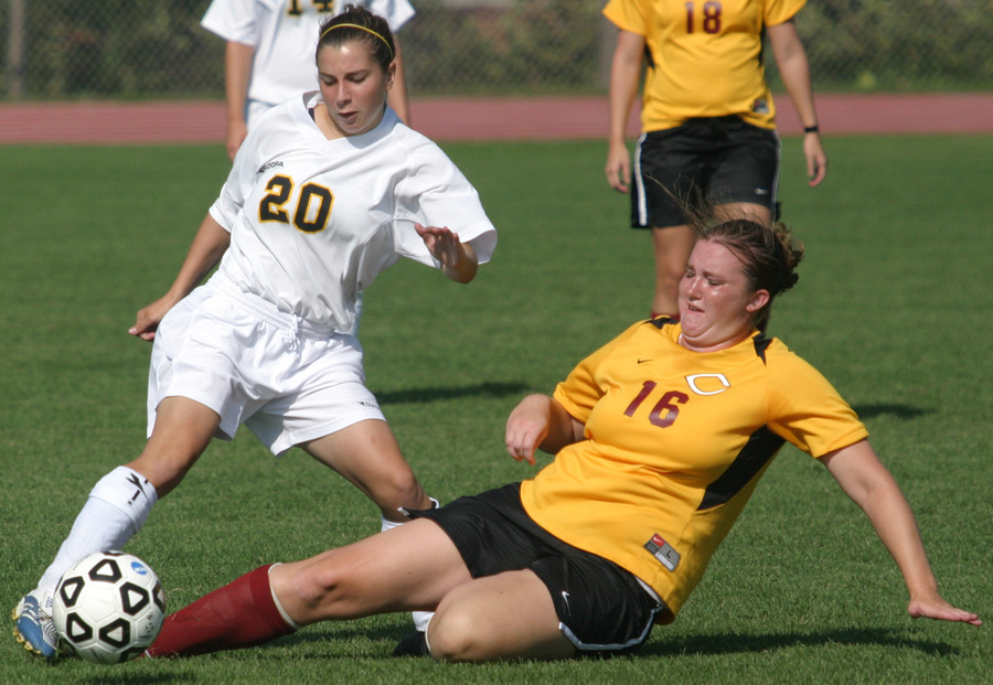 Chelsea Craven tries to keep the ball away from a sliding Cobber.