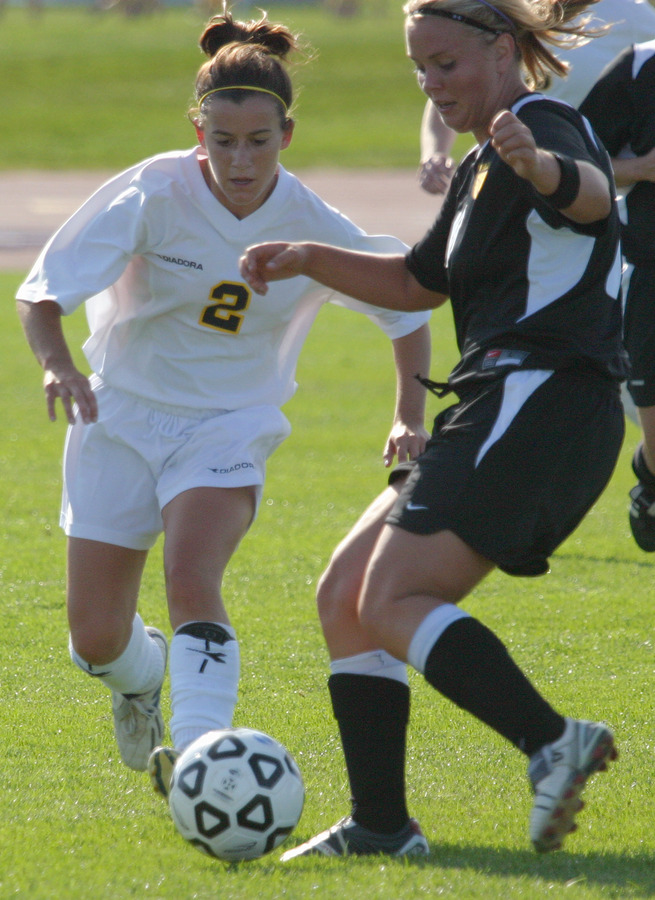 Kirsten Thulien looks to take the ball away from a Wildcat.