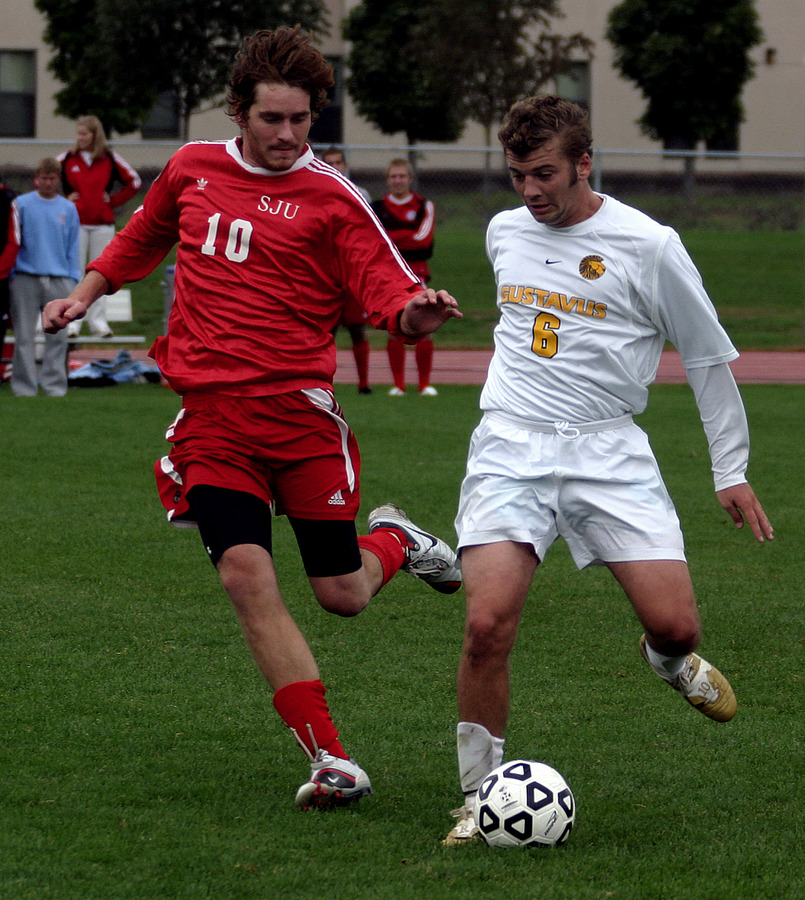Midfielder Jeffrey Johnson plays the ball up the field.