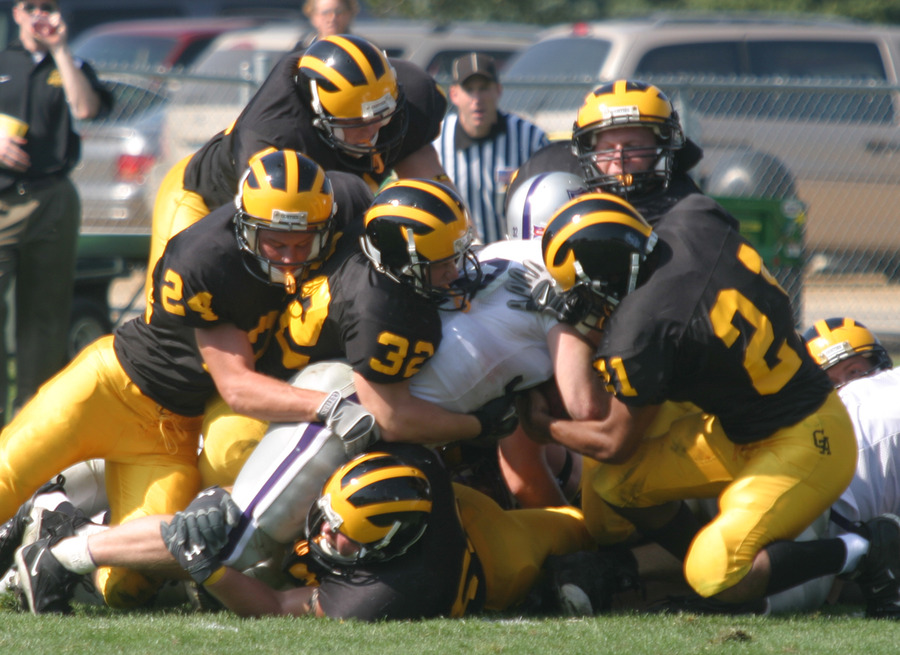 The Gustie defense makes a gang-tackle.