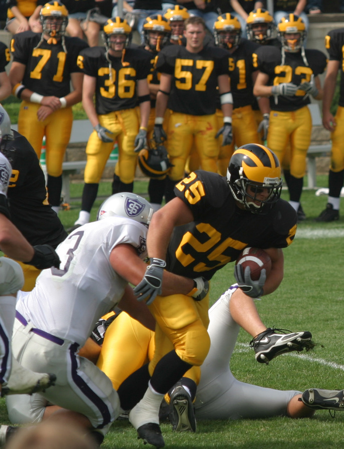 Running back Mitch Anderson busts through the line against St. Thomas.