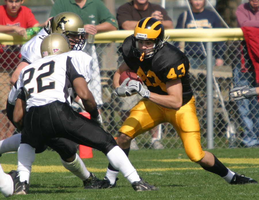 Chad Arlt makes a move on a St. Olaf defender