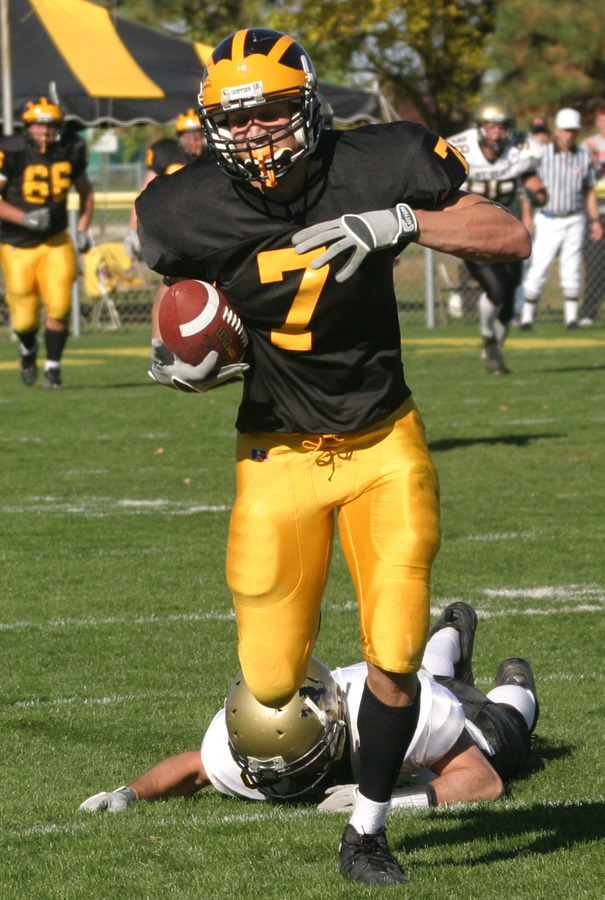 Senior wide receiver Kerry Zajicek breaks a tackle en route to a 97-yard touchdown reception against the Oles.