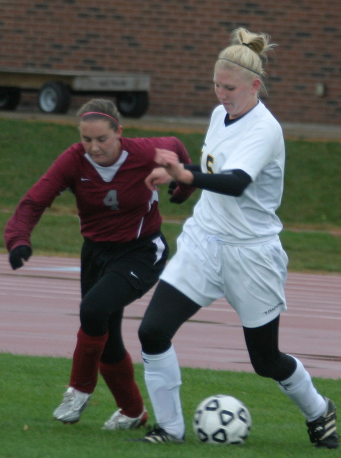 Rachel Gieseke plays the ball.