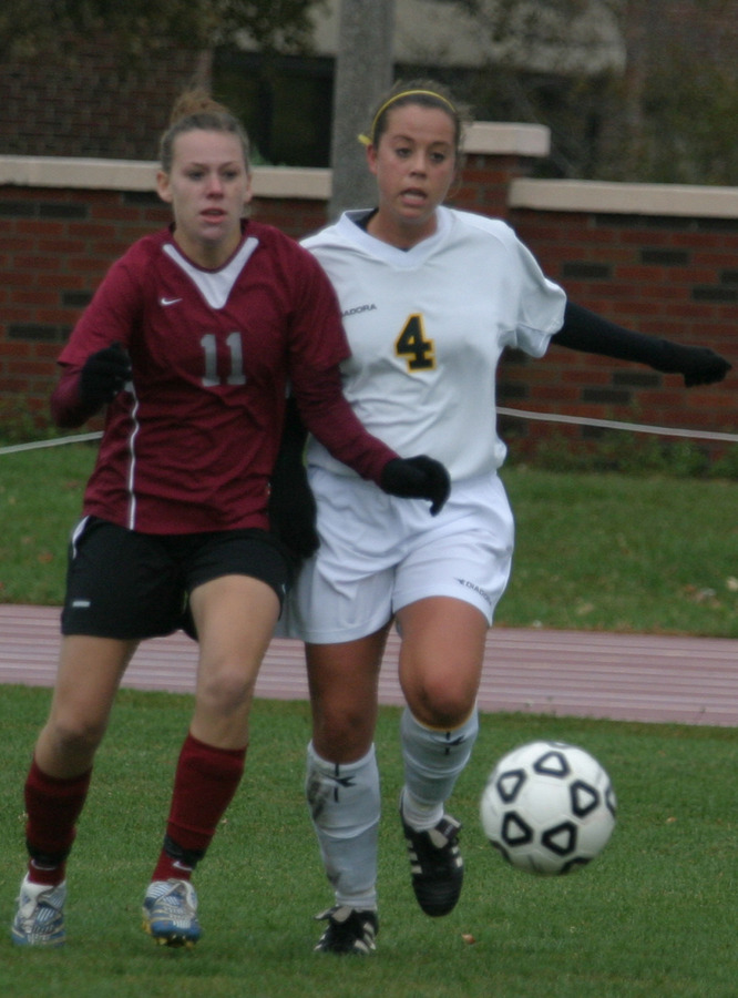 Megan Tepper and an Eagle look to make a play on the ball.