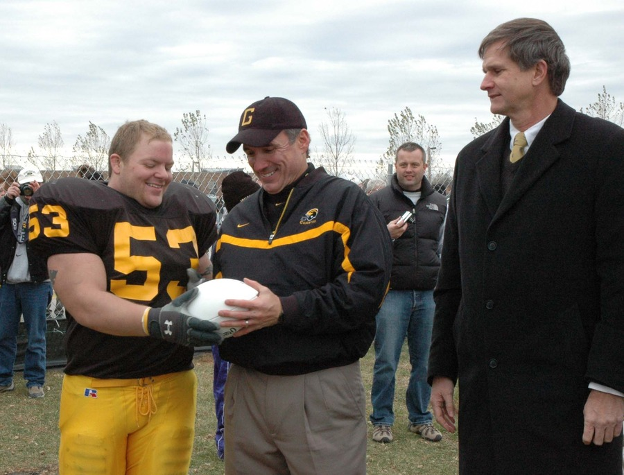 A football, and the tradition it represents, is passed from the current stadium to the location of the new field.