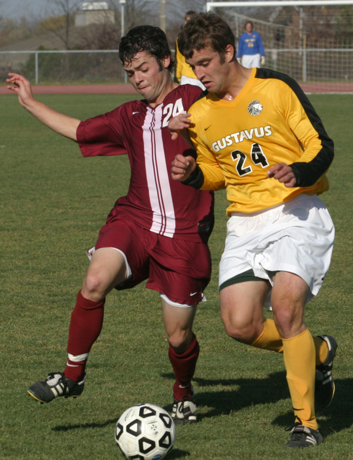 Alex Groth battles a Piper defender for possession.