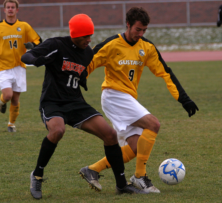 Dane Obermeyer looks to win the ball from a Wartburg player.