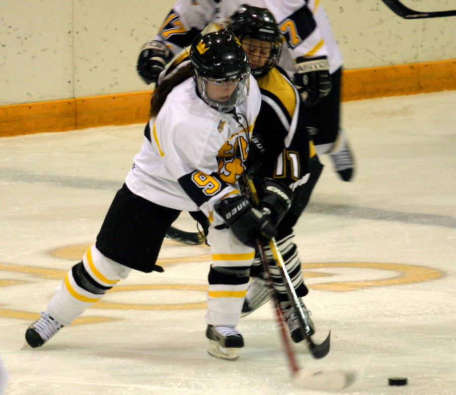 Kelly Crandall battles for the puck.