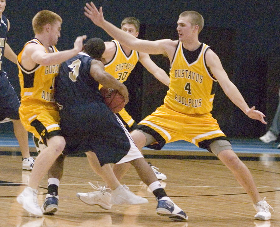 Mike DesLauriers (left) and Kane Sivesind (right) try to bottle up Buena Vista's Rahn Franklin.