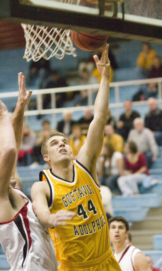 Senior Phil Sowden goes up for a lay-up against Carthage.