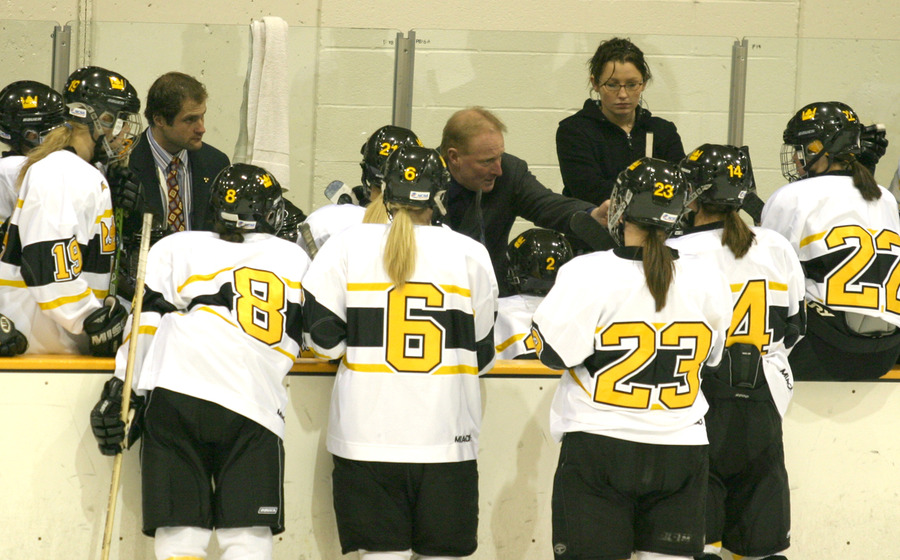 Gustavus talks strategy during a timeout.