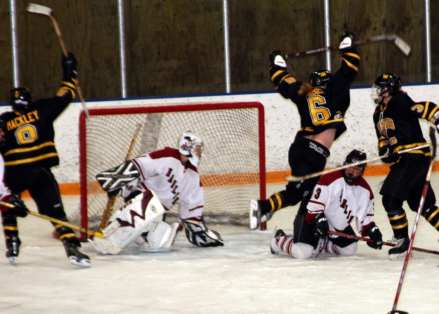 Jenny Pusch (#6) scores in overtime (Photo by Fred Cotey)