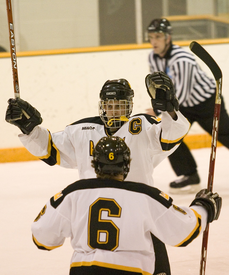 Hosfield celebrates his game-winning goal with Cody Mosbeck (#6).