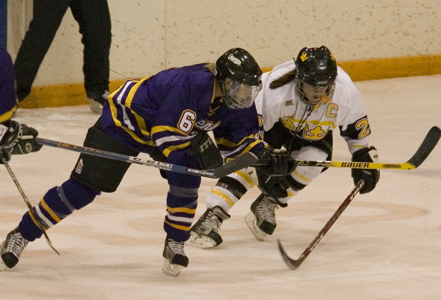 Andrea Peterson (right) scored three assists while keeping Nicole Grossman (left) without a point.