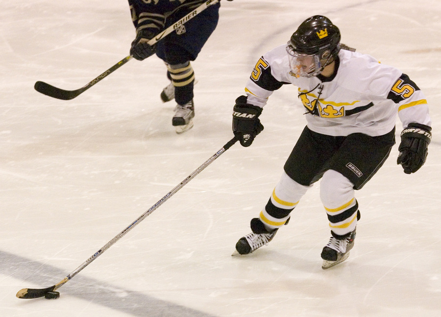Mari Gunderson plays the puck across the blue line.