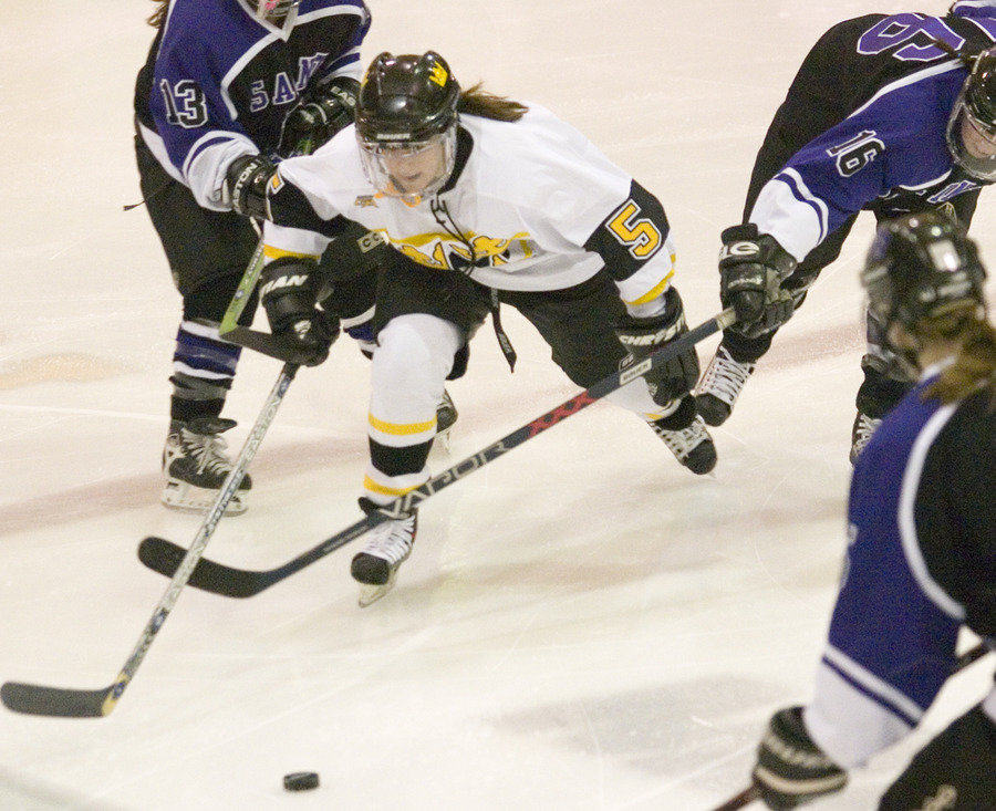 Mari Gunderson fights through a trio of Tommy defenders.