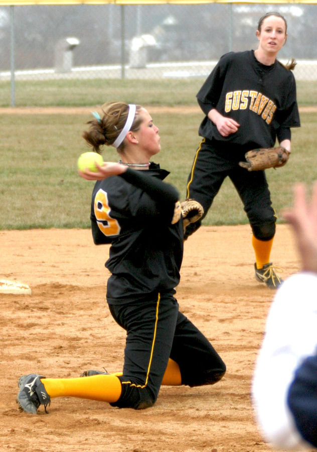 Shortstop Rachael Click throws out a runner from her knees in game one.