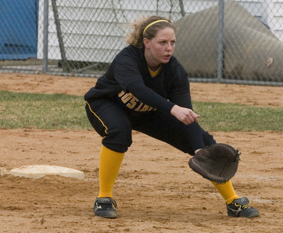 Senior captain Tina Strauss gets set to field a ball at first base.